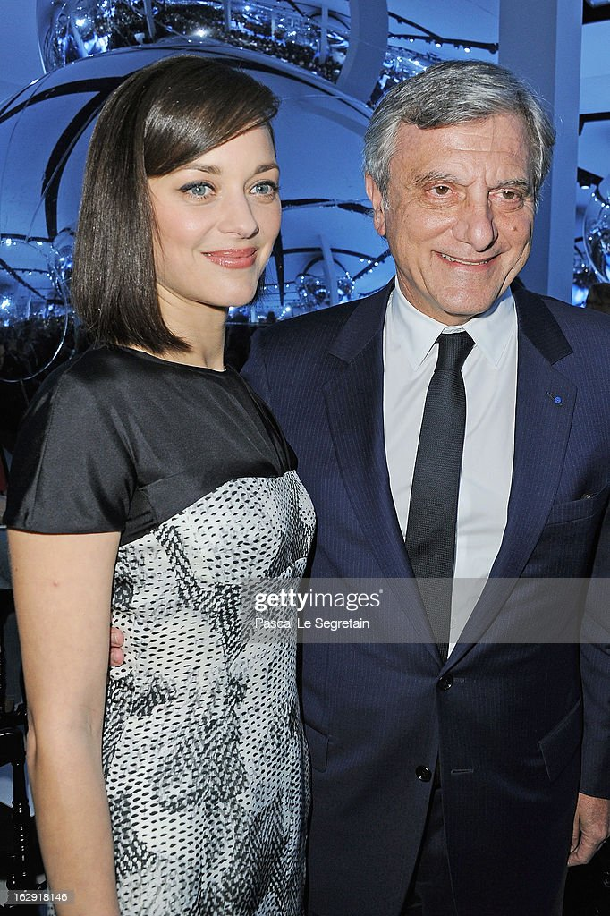 Marion Cotillard (L) and Sydney Toledano attend the Christian Dior Fall/Winter 2013 Ready-to-Wear show as part of Paris Fashion Week on March 1, 2013 in Paris, France.