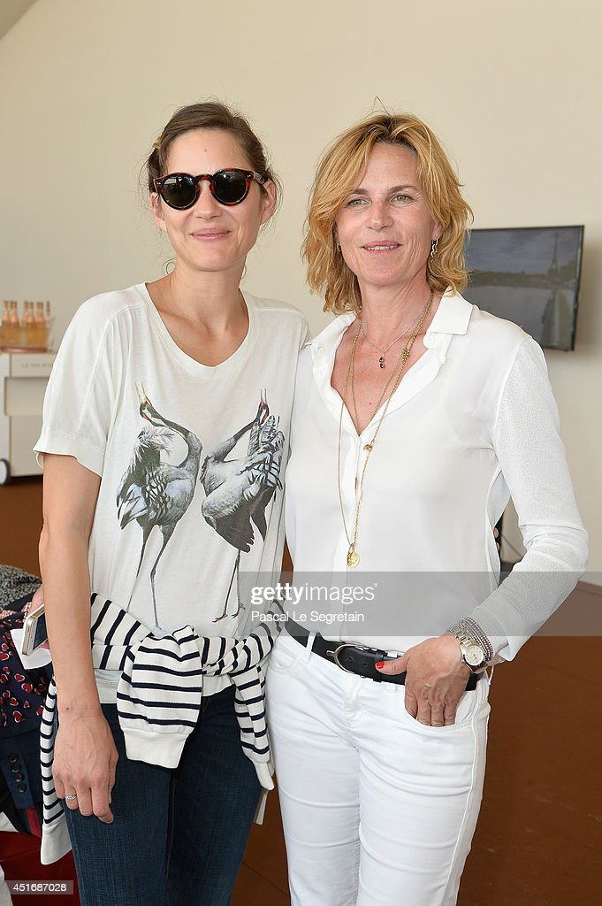 Marion Cotillard and Virginie Couperie-Eiffel attend the Paris Eiffel Jumping presented by Gucci at Champ-de-Mars on July 4, 2014 in Paris, France.