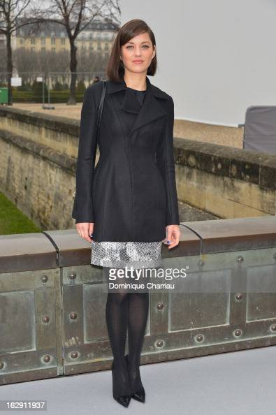 Marion Cotillard arrives at the Christian Dior Fall/Winter 2013 ReadytoWear show as part of Paris Fashion Week on March 1 2013 in Paris France