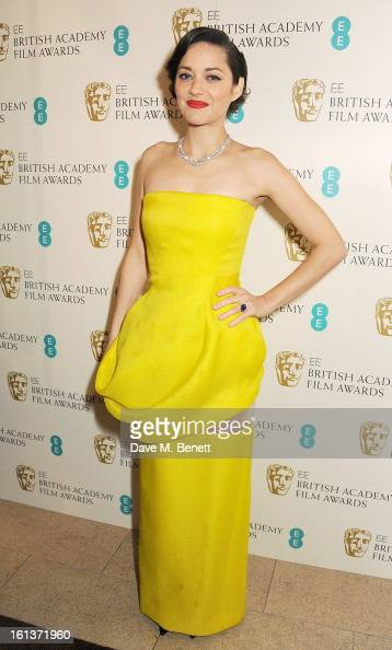 Marion Cotillard arrives at the EE British Academy Film Awards at the Royal Opera House on February 10 2013 in London England