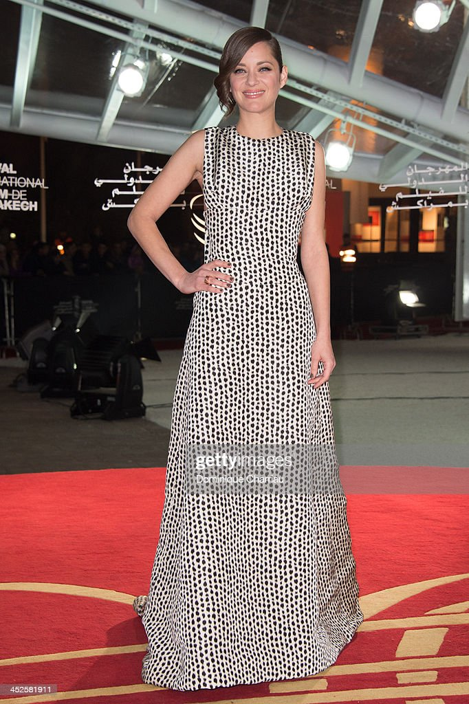 <a gi-track='captionPersonalityLinkClicked' href=/galleries/search?phrase=Marion+Cotillard&family=editorial&specificpeople=215303 ng-click='$event.stopPropagation()'>Marion Cotillard</a> arrives at the opening ceremony of the 13th Marrakesh International Film Festival on November 29, 2013 in Marrakech, Morocco.