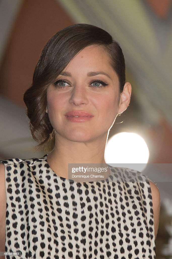 Marion Cotillard arrives at the opening ceremony of the 13th Marrakesh International Film Festival on November 29, 2013 in Marrakech, Morocco.