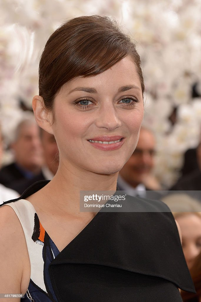 <a gi-track='captionPersonalityLinkClicked' href=/galleries/search?phrase=Marion+Cotillard&family=editorial&specificpeople=215303 ng-click='$event.stopPropagation()'>Marion Cotillard</a> attends at the Christian Dior show as part of Paris Fashion Week - Haute Couture Fall/Winter 2014-2015 at on July 7, 2014 in Paris, France.