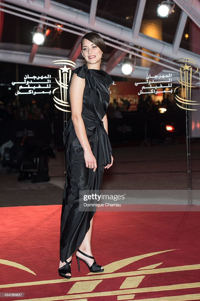 <a gi-track='captionPersonalityLinkClicked' href=/galleries/search?phrase=Marion+Cotillard&family=editorial&specificpeople=215303 ng-click='$event.stopPropagation()'>Marion Cotillard</a> attends the award Ceremony 2013' At 13th Marrakech International Film Festival on December 7, 2013 in Marrakech, Morocco.