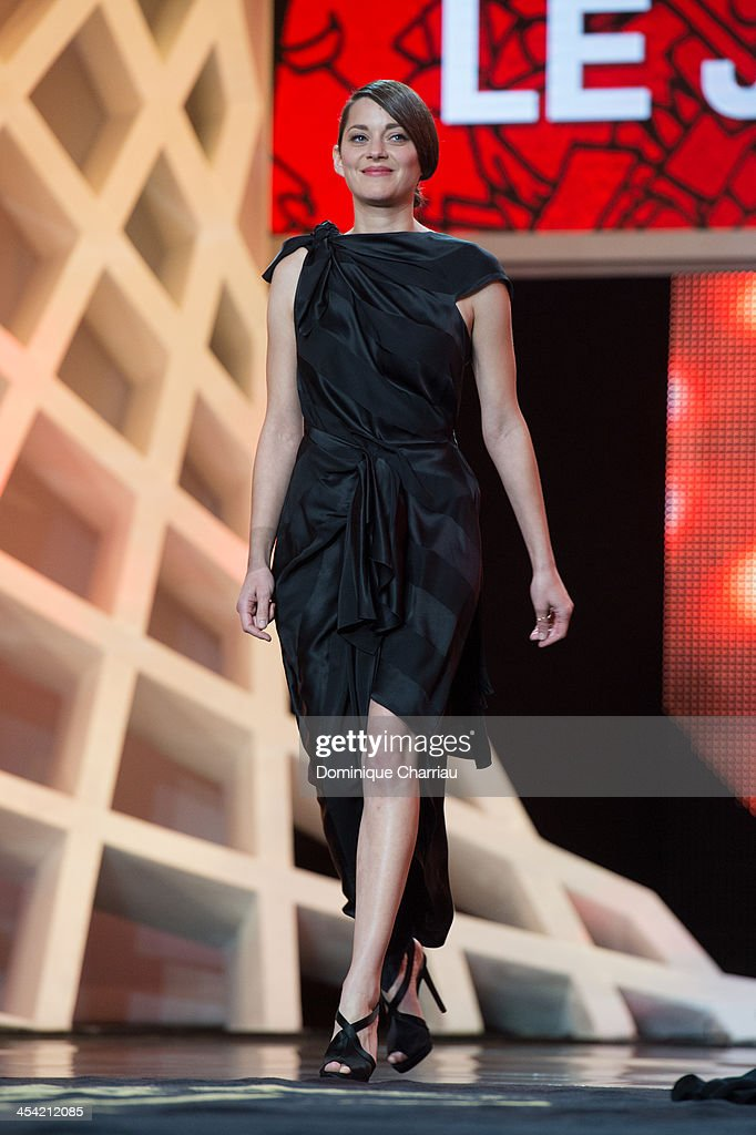 <a gi-track='captionPersonalityLinkClicked' href=/galleries/search?phrase=Marion+Cotillard&family=editorial&specificpeople=215303 ng-click='$event.stopPropagation()'>Marion Cotillard</a> attends the Award Ceremony of the 13th Marrakech International Film Festival on December 7, 2013 in Marrakech, Morocco.