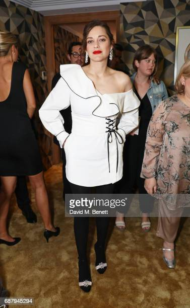 Marion Cotillard attends the Chopard and Annabel's Gentleman's Evening at the Hotel Martinez during the 70th Annual Cannes Film Festival on May 24...