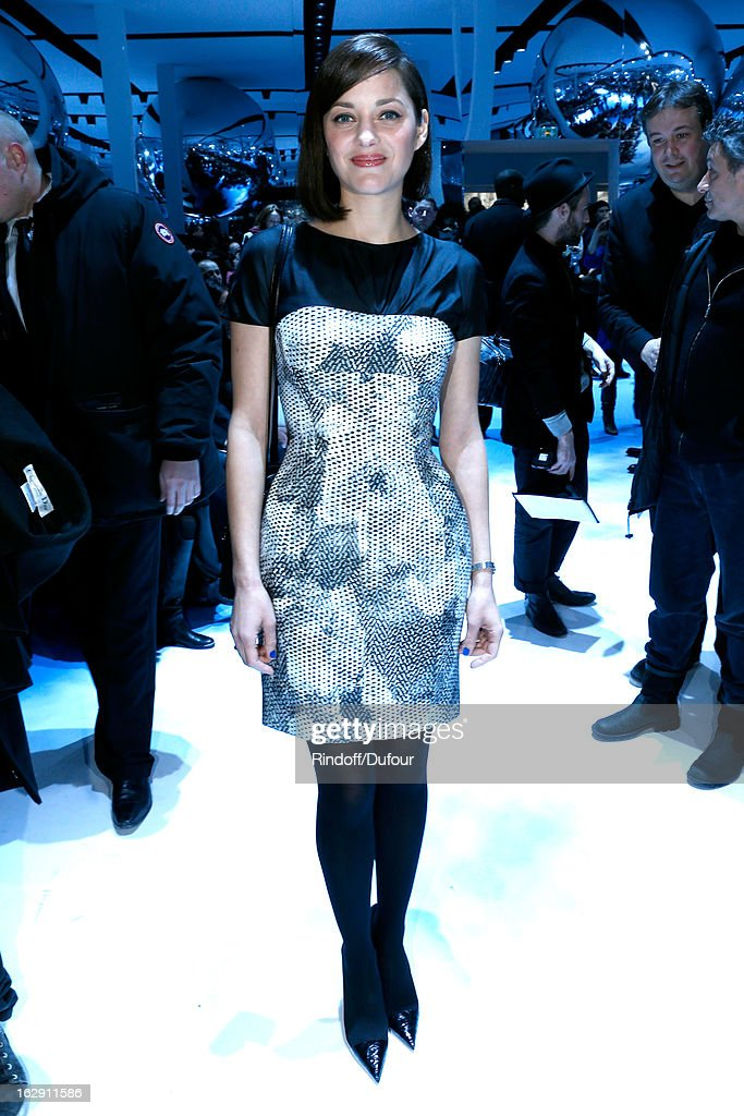 <a gi-track='captionPersonalityLinkClicked' href=/galleries/search?phrase=Marion+Cotillard&family=editorial&specificpeople=215303 ng-click='$event.stopPropagation()'>Marion Cotillard</a> attends the Christian Dior Fall/Winter 2013 Ready-to-Wear show as part of Paris Fashion Week on March 1, 2013 in Paris, France.