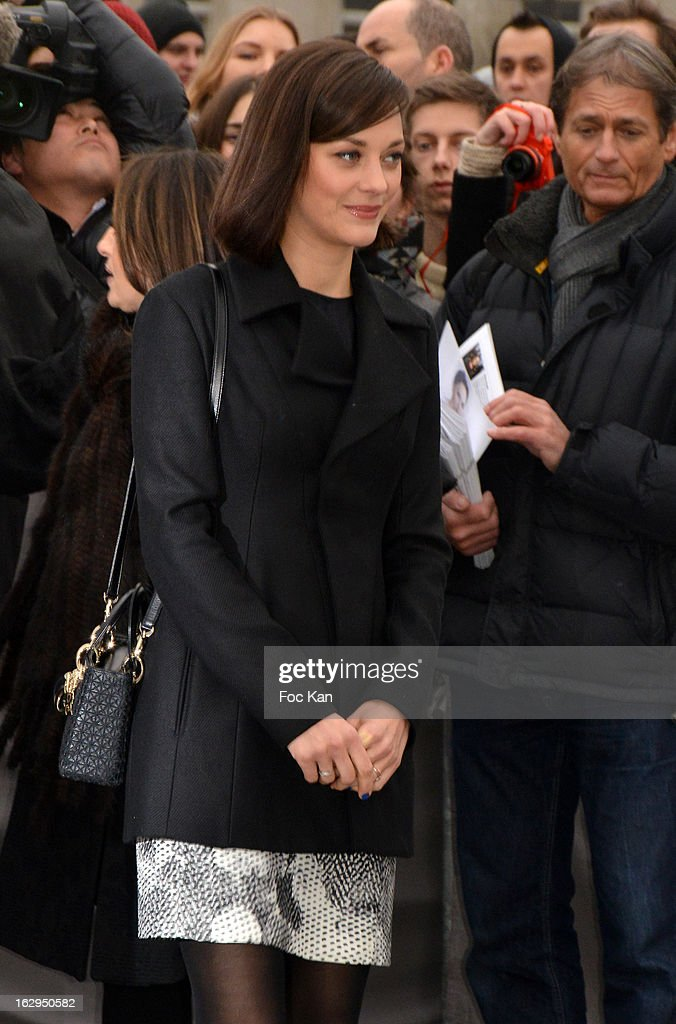 <a gi-track='captionPersonalityLinkClicked' href=/galleries/search?phrase=Marion+Cotillard&family=editorial&specificpeople=215303 ng-click='$event.stopPropagation()'>Marion Cotillard</a> attends the Christian Dior - Outside Arrivals - PFW F/W 2013 at Hotel des Invalides on March 1rst, 2013 in Paris, France.
