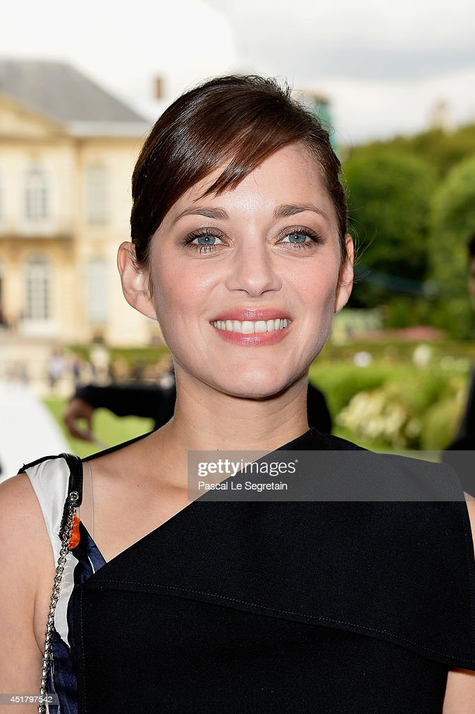 <a gi-track='captionPersonalityLinkClicked' href=/galleries/search?phrase=Marion+Cotillard&family=editorial&specificpeople=215303 ng-click='$event.stopPropagation()'>Marion Cotillard</a> attends the Christian Dior show as part of Paris Fashion Week - Haute Couture Fall/Winter 2014-2015 on July 7, 2014 in Paris, France.