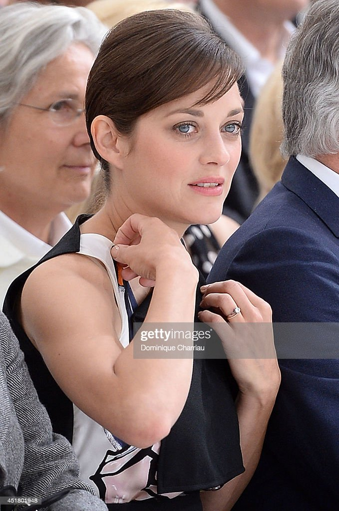 Marion Cotillard attends the Christian Dior show as part of Paris Fashion Week - Haute Couture Fall/Winter 2014-2015 on July 7, 2014 in Paris, France.