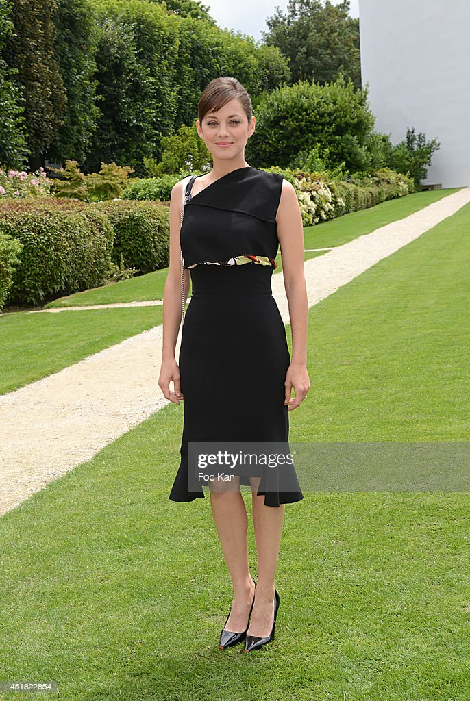 <a gi-track='captionPersonalityLinkClicked' href=/galleries/search?phrase=Marion+Cotillard&family=editorial&specificpeople=215303 ng-click='$event.stopPropagation()'>Marion Cotillard</a> attends the Christian Dior Show as part of Paris Fashion Week - Haute Couture Fall/Winter 2014-2015 at Musee Rodin on July 7, 2014 in Paris, France.