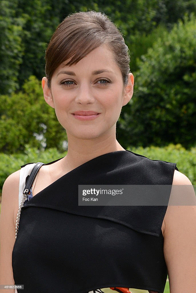 Marion Cotillard attends the Christian Dior Show as part of Paris Fashion Week - Haute Couture Fall/Winter 2014-2015 at Musee Rodin on July 7, 2014 in Paris, France.