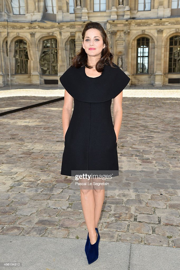 <a gi-track='captionPersonalityLinkClicked' href=/galleries/search?phrase=Marion+Cotillard&family=editorial&specificpeople=215303 ng-click='$event.stopPropagation()'>Marion Cotillard</a> attends the Christian Dior show as part of the Paris Fashion Week Womenswear Spring/Summer 2015 on September 26, 2014 in Paris, France.