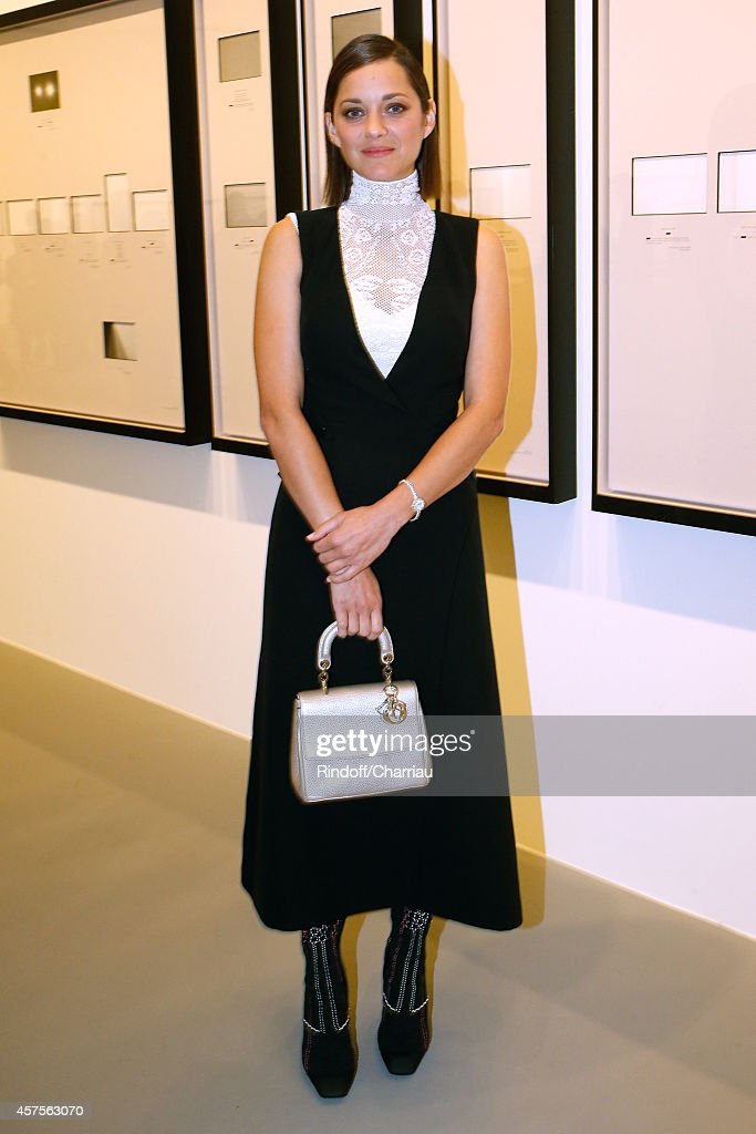 <a gi-track='captionPersonalityLinkClicked' href=/galleries/search?phrase=Marion+Cotillard&family=editorial&specificpeople=215303 ng-click='$event.stopPropagation()'>Marion Cotillard</a> attends the Foundation Louis Vuitton Opening at Foundation Louis Vuitton on October 20, 2014 in Boulogne-Billancourt, France.