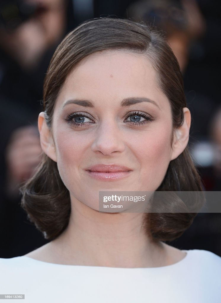<a gi-track='captionPersonalityLinkClicked' href=/galleries/search?phrase=Marion+Cotillard&family=editorial&specificpeople=215303 ng-click='$event.stopPropagation()'>Marion Cotillard</a> attends 'The Immigrant' Premiere during the 66th Annual Cannes Film Festival at Grand Theatre Lumiere on May 24, 2013 in Cannes, France.