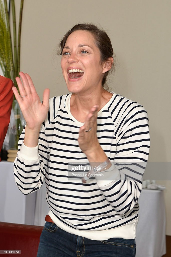 Marion Cotillard attends the Paris Eiffel Jumping presented by Gucci at Champ-de-Mars on July 4, 2014 in Paris, France.