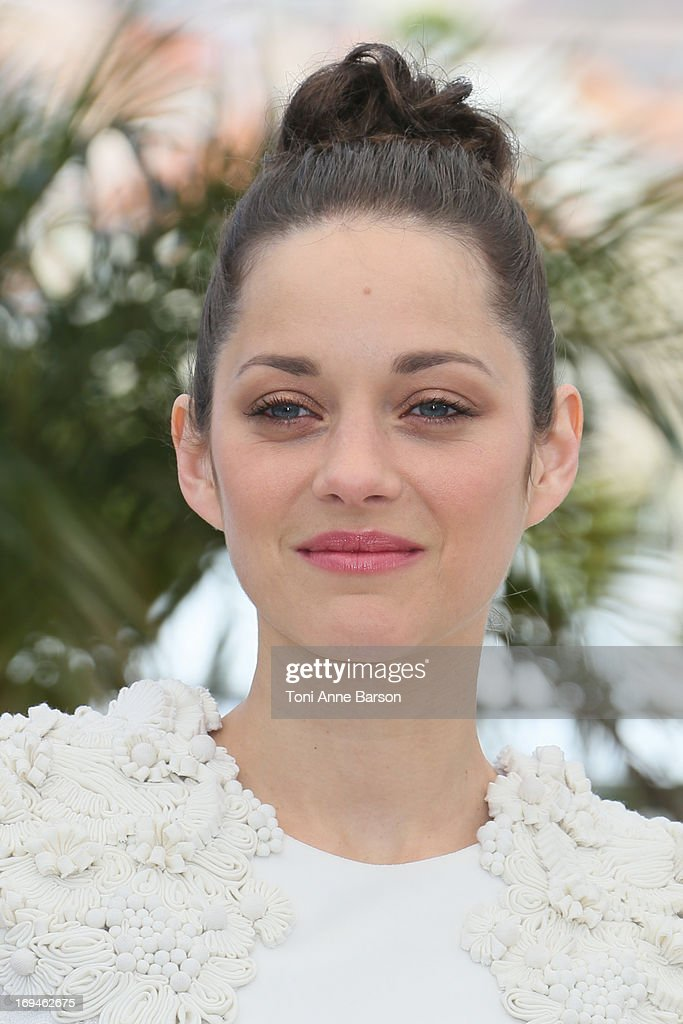 <a gi-track='captionPersonalityLinkClicked' href=/galleries/search?phrase=Marion+Cotillard&family=editorial&specificpeople=215303 ng-click='$event.stopPropagation()'>Marion Cotillard</a> attends the photocall for 'The Immigrant' at The 66th Annual Cannes Film Festival on May 24, 2013 in Cannes, France.