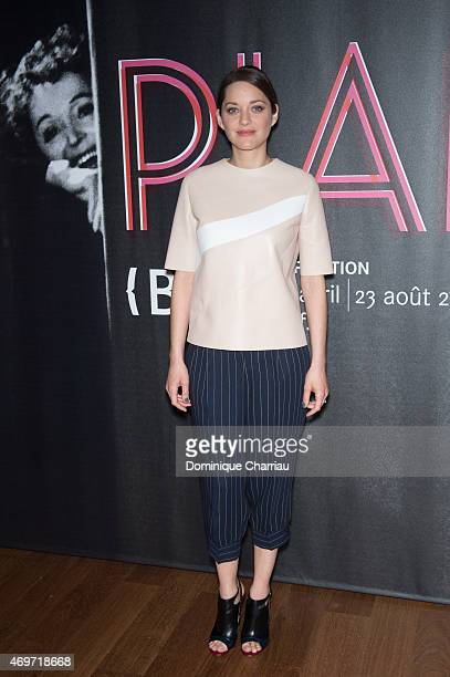 Marion Cotillard attends the PIAF Exhibition celebrating Edith Piaf's birth centenary opening photocall at Bibliotheque Nationale de France on April...