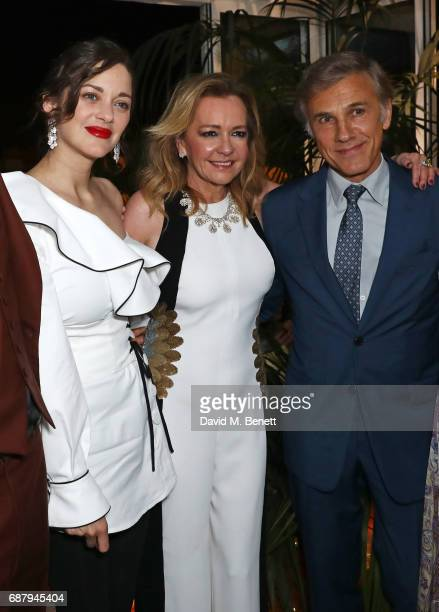 Marion Cotillard Caroline Scheufele Artistic Director and CoPresident of Chopard and Christoph Waltz attend the Chopard and Annabel's Gentleman's...