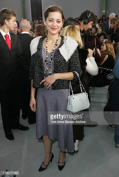 Marion Cotillard during Paris Fashion Week Pret a Porter Spring/Summer 2006 Chanel Front Row at Grand Palais in Paris France