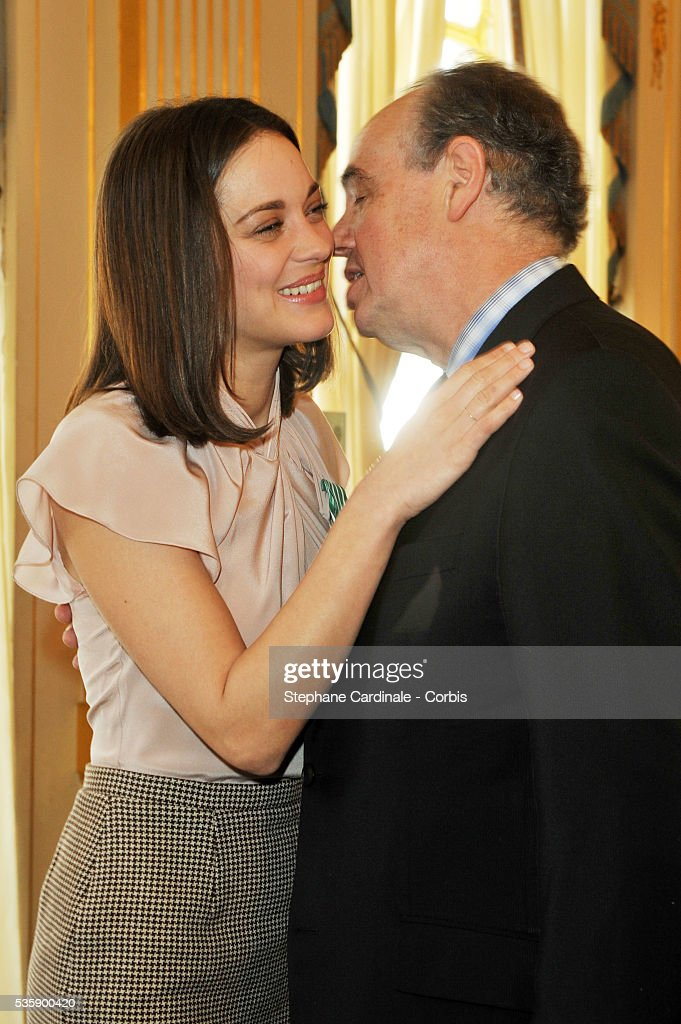 Marion Cotillard is awarded Chevalier in the Order of Art and Letters by Culture Minister Frederic Mitterand, at the Department of Culture in Paris.