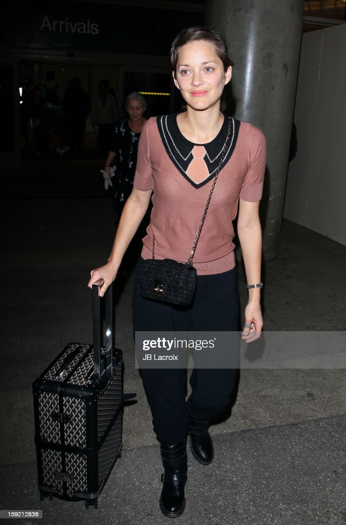 <a gi-track='captionPersonalityLinkClicked' href=/galleries/search?phrase=Marion+Cotillard&family=editorial&specificpeople=215303 ng-click='$event.stopPropagation()'>Marion Cotillard</a> is seen at LAX Airport on January 9, 2013 in Los Angeles, California.