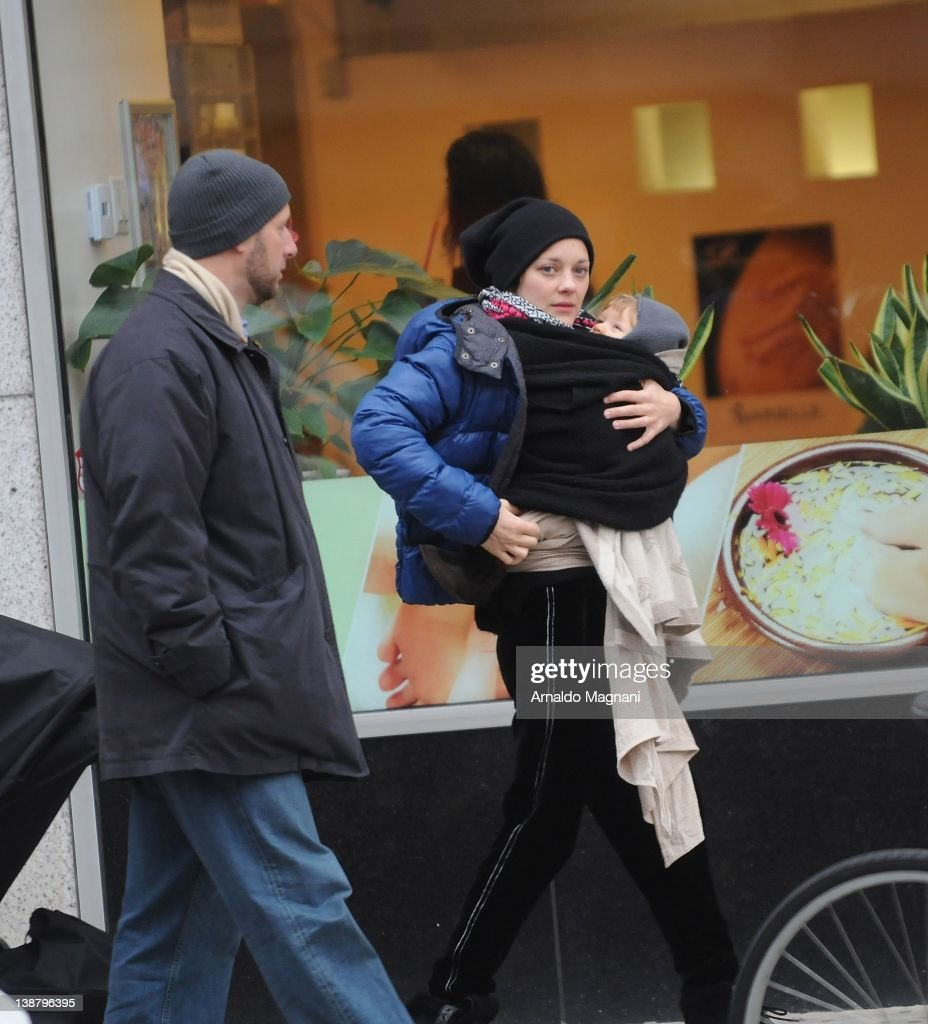 Marion Cotillard is sighted shopping with her baby son Marcel and husband Guillaume Canet on February 11 2012 in New York City
