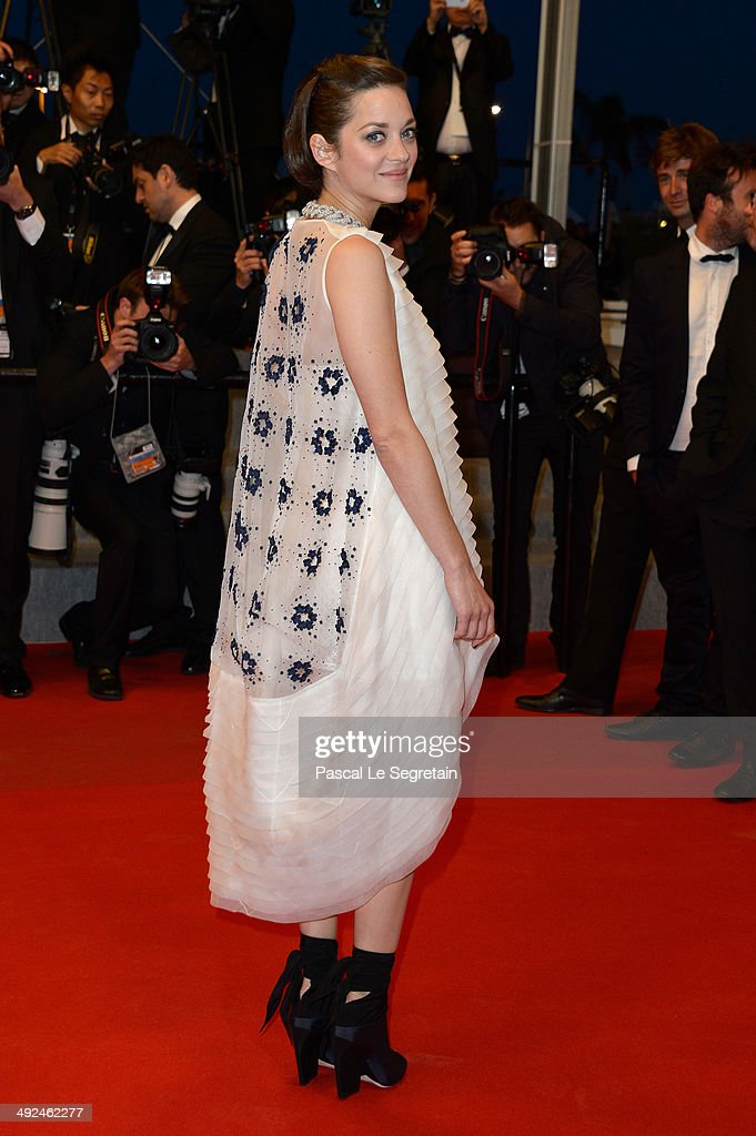 Marion Cotillard leaves the 'Two Days, One Night' (Deux Jours, Une Nuit) premiere during the 67th Annual Cannes Film Festival on May 20, 2014 in Cannes, France.