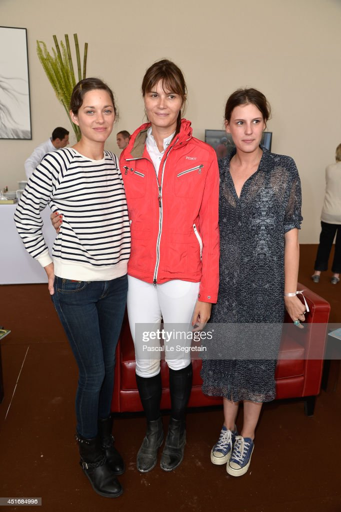 Marion Cotillard, Marina Hands and Juliette Maillot attend the Paris Eiffel Jumping presented by Gucci at Champ-de-Mars on July 4, 2014 in Paris, France.