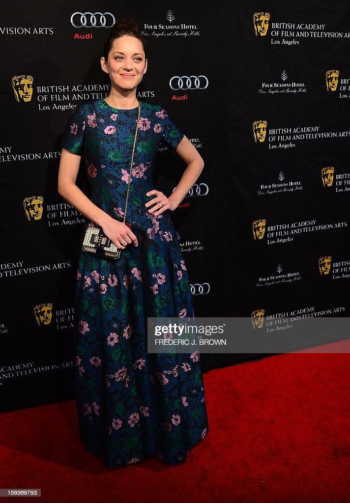 Marion Cotillard poses on arrival for the British Academy of Film and Television Arts (BAFTA) Los Angeles Awards Season Tea Party on January 12, 2013 in Beverly Hills, California. AFP PHOTO / Frederic J. BROWN