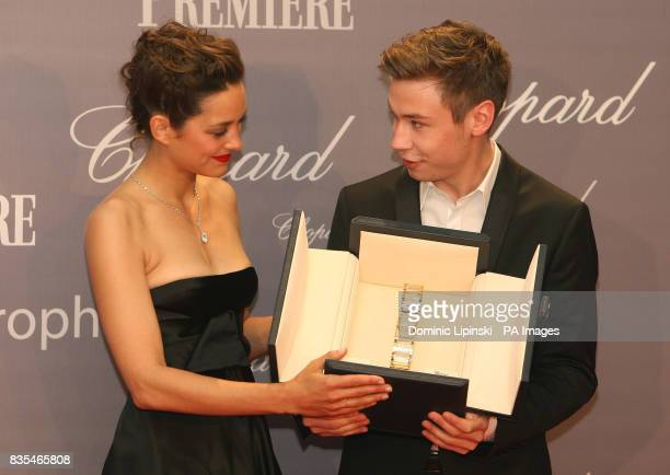 Marion Cotillard presents David Kross with the Chopard Trophy 2009 at the Martinez Hotel as part of the 62nd annual Cannes Film Festival