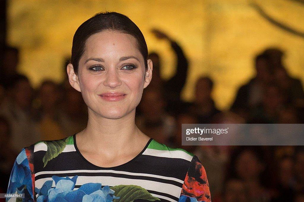 <a gi-track='captionPersonalityLinkClicked' href=/galleries/search?phrase=Marion+Cotillard&family=editorial&specificpeople=215303 ng-click='$event.stopPropagation()'>Marion Cotillard</a> presents the Michael Mann film ''Public Enemies' at Jemaa El Fna square at 13th Marrakech International Film Festival on December 5, 2013 in Marrakech, Morocco.
