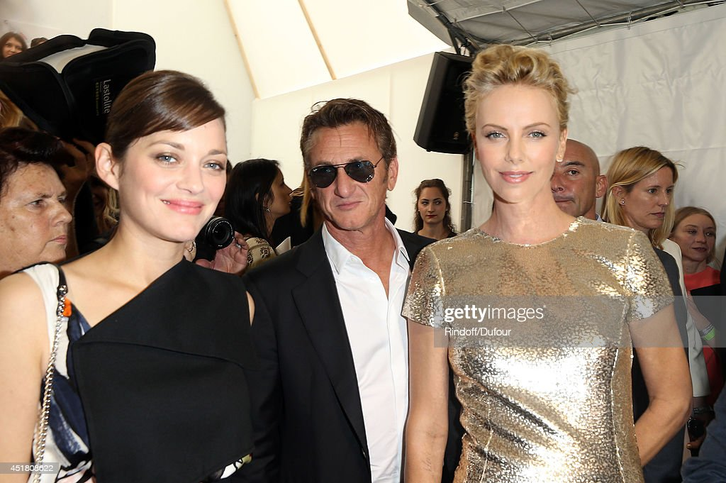 <a gi-track='captionPersonalityLinkClicked' href=/galleries/search?phrase=Marion+Cotillard&family=editorial&specificpeople=215303 ng-click='$event.stopPropagation()'>Marion Cotillard</a>, <a gi-track='captionPersonalityLinkClicked' href=/galleries/search?phrase=Sean+Penn&family=editorial&specificpeople=202979 ng-click='$event.stopPropagation()'>Sean Penn</a> and <a gi-track='captionPersonalityLinkClicked' href=/galleries/search?phrase=Charlize+Theron&family=editorial&specificpeople=171250 ng-click='$event.stopPropagation()'>Charlize Theron</a> attend in backstage the Christian Dior show as part of Paris Fashion Week - Haute Couture Fall/Winter 2014-2015 at Muse Rodin on July 7, 2014 in Paris, France.
