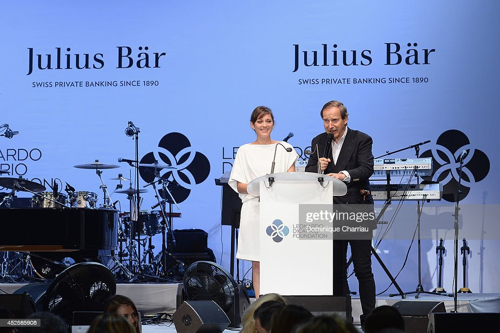 Marion Cotillard (L) speaks on stage during the Leonardo Dicaprio Foundation Launch at Domaine Bertaud Belieu on July 23, 2014 in Saint-Tropez, France.