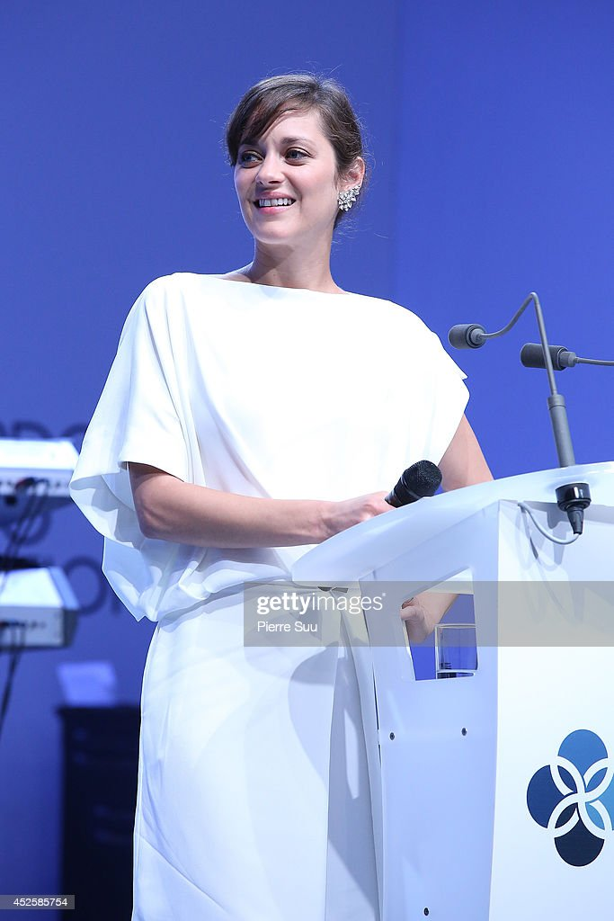 Marion Cotillard speaks onstage during the Leonardo Dicaprio Foundation Inaugurational Gala at Domaine Bertaud Belieu on July 23, 2014 in Saint-Tropez, France.