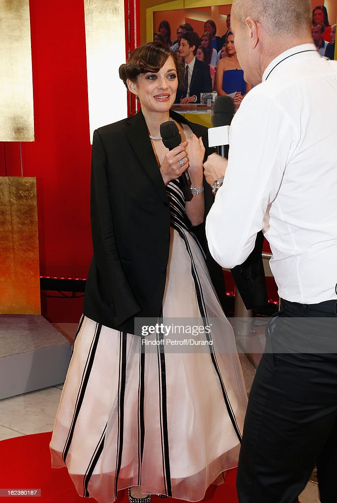 Marion Cotillard talks during a live broadcast after she arrived to attend the Cesar Film Awards 2013 at Theatre du Chatelet on February 22, 2013 in Paris, France.