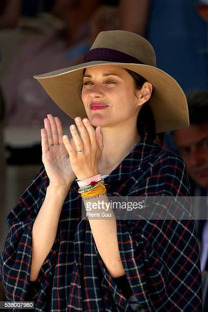 Marion Cotillard watches her husband Guillaume Canet competing at the Longines Athina Onassis Horse Show on June 4 2016 in SaintTropez France