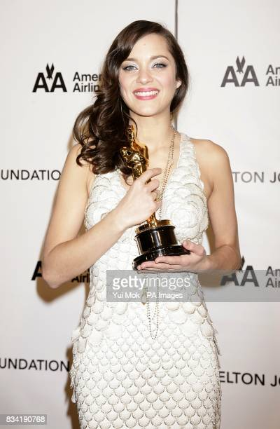 Marion Cotillard with her Oscar for Best Leading Actress arrives for the 16th Annual Sir Elton John AIDS Foundation Oscar Party at the Pacific Design...