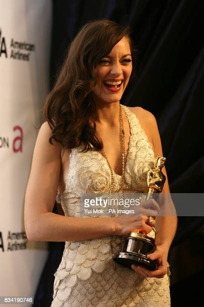 Marion Cotillard with the award for Best Actress arrives for the 16th Annual Sir Elton John AIDS Foundation Oscar Party at the Pacific Design Centre...