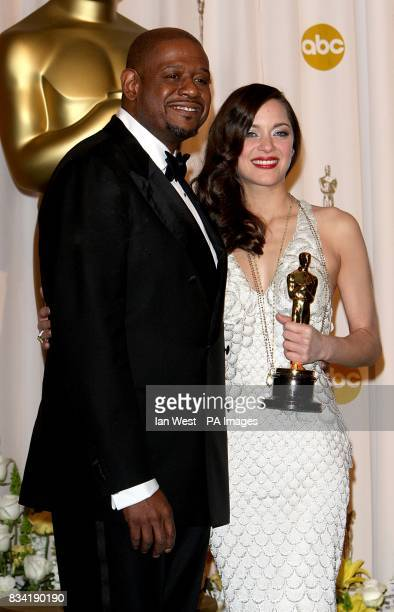 Marion Cotillard with the award for Best Actress in a Leading Role received for La Vie En Rose and Forest Whitaker at the 80th Academy Awards at the...