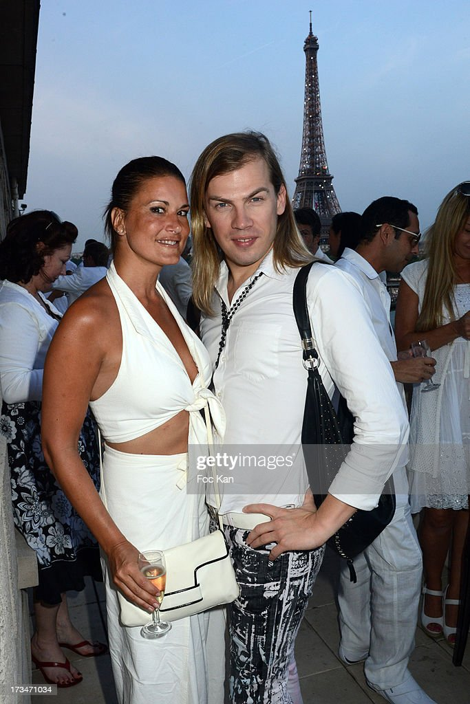 Marion Dumas and Christophe Guillarme attend the 14th July White Party at the Pierre Guillermo residence on July 14, 2013 in Paris, France.