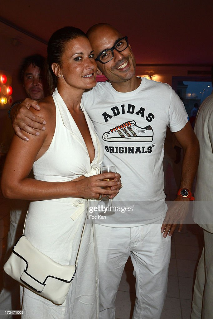 Marion Dumas and Marc Fichel attend the 14th July White Party at the Pierre Guillermo residence on July 14, 2013 in Paris, France.