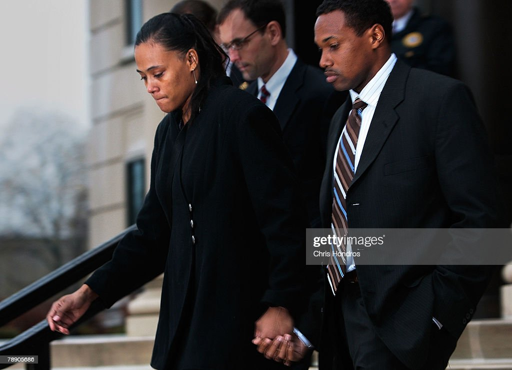 Marion Jones (L) walks with her husband Obadele Thompson after she leaves court January 11, 2008 in White Plains, New York. Marion Jones was sentenced to six months in prison for lying about using steroids during her athletic career and a check-fraud scam.