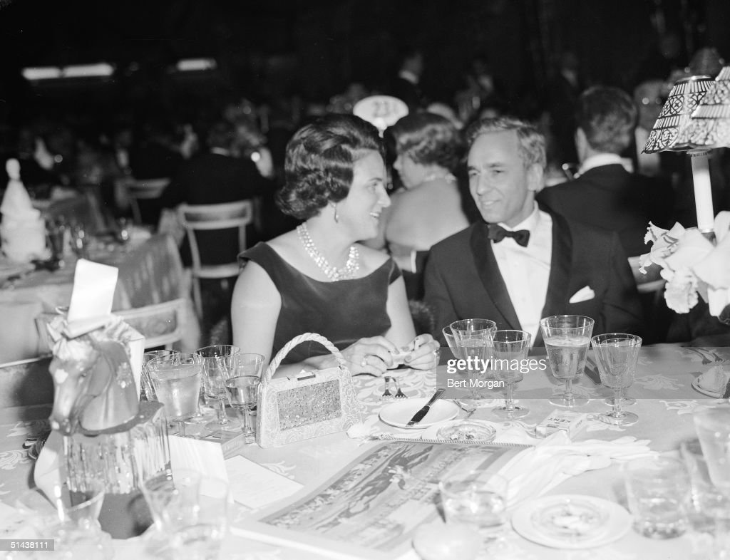 Marion Leiter talks with American AP supermarket heir and art collector Huntington Hartford at the April in Paris Ball New York New York October 20...