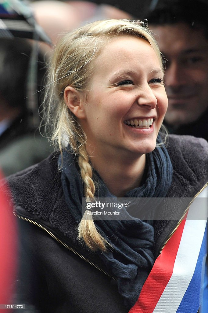 <a gi-track='captionPersonalityLinkClicked' href=/galleries/search?phrase=Marion+Marechal-Le+Pen&family=editorial&specificpeople=6562007 ng-click='$event.stopPropagation()'>Marion Marechal-Le Pen</a>, member of the Front National and Spokesman for Vaucluse's 3rd constituency walks with the crowd during the party's annual rally honoring Joan of Arc on Place de l'Opera, on May 1, 2015 in Paris, France. Annually over 1000 people from the FN Party demonstrate on May 1st.