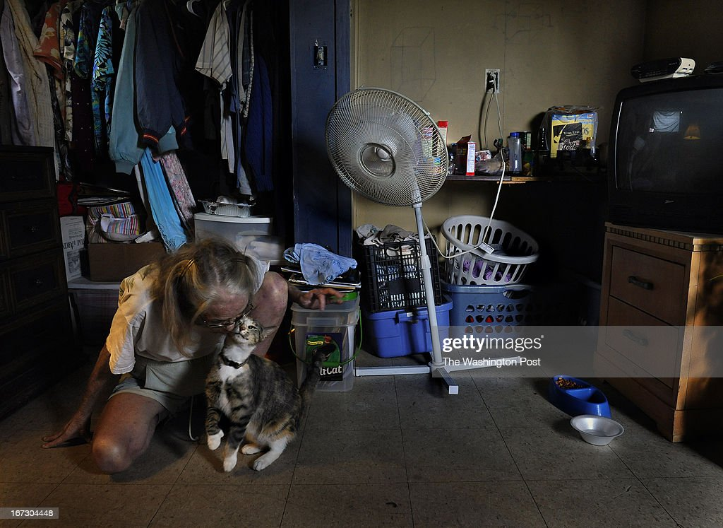 Marion Mattrazzo, 54, suffers from Cirrhosis of the Liver and lives on about $7,000 per year. She gets a snuggle smooch from her cat named Kitty after she got back from the food pantry. She signed up for the SNAP program because what little income she has goes for medical related expenses (she's too young to be eligible for Medicare). She once had a vibrant construction company that suffered badly with the housing collapse in Florida. Adding to her difficulty was that her husband died two years ago. She now rents (for $200 a month) a100 square foot shack (pictured) that was tacked onto a garage. The SNAP program is a huge help to her but because she has no stove, she has to buy a lot of microwaveable foods. She's been feeling depressed of late about her current circumstances, 'I'm just existing at this point,' she said. Many low-income seniors qualify to participate in the S.N.A.P. (food stamps) program but do not receive the benefit, often because they are too proud or unaware of it. Photo by Michael S. Williamson/The Washington Post via Getty Images