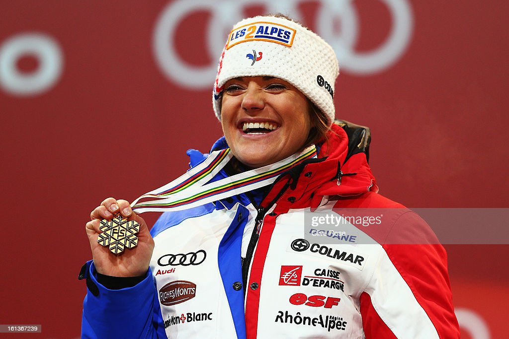 <a gi-track='captionPersonalityLinkClicked' href=/galleries/search?phrase=Marion+Rolland&family=editorial&specificpeople=2085752 ng-click='$event.stopPropagation()'>Marion Rolland</a> of France celebrates at the medal ceremony with her gold medal after winning the Women's Downhill during the Alpine FIS Ski World Championships on February 10, 2013 in Schladming, Austria.