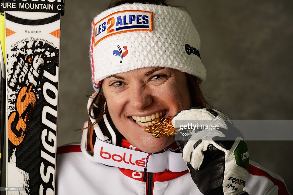 <a gi-track='captionPersonalityLinkClicked' href=/galleries/search?phrase=Marion+Rolland&family=editorial&specificpeople=2085752 ng-click='$event.stopPropagation()'>Marion Rolland</a> of France celebrates with her gold medal after winning the Women's Downhill during the Alpine FIS Ski World Championships on February 10, 2013 in Schladming, Austria.