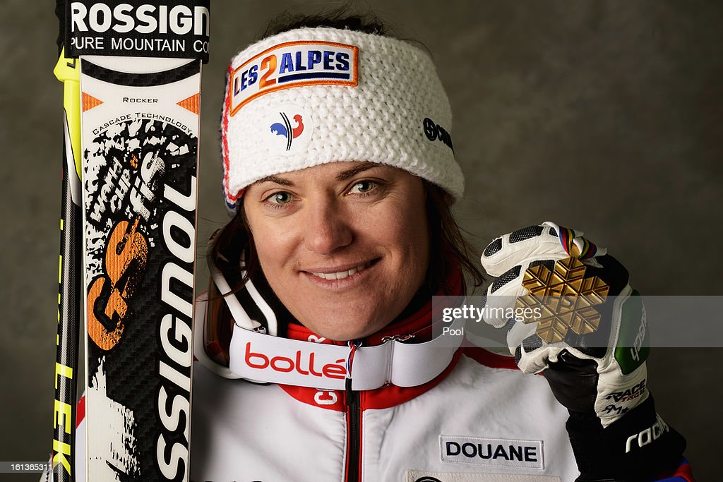 Marion Rolland of France celebrates with her gold medal after winning the Women's Downhill during the Alpine FIS Ski World Championships on February 10, 2013 in Schladming, Austria.