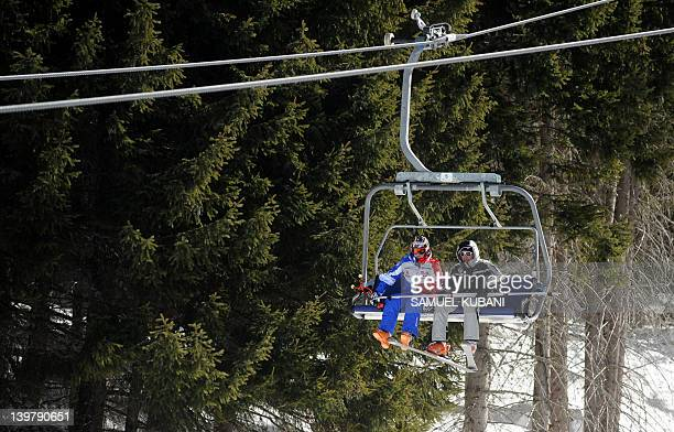 Marion Rolland of France uses a ski lift after the Fis Alpine Ski World Cup women's Downhill race was canceled due to heavy wind in Bansko on...